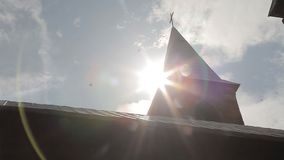 Roof of the church with a cross. The flare of the sun stock video footage