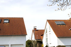 Roof of classic residential houses with orange roofing tiles and Royalty Free Stock Images