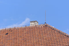 Roof of clay tiles with chimney Royalty Free Stock Photo