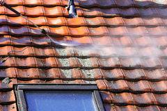 Roof cleaning with high pressure Stock Images