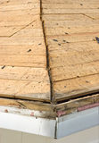 Roof Cleared of Of Old, Leaking House Shingles. Tear off of old shingles has been completed and this image shows the detail of the wooden deck of the roof at the Stock Photos