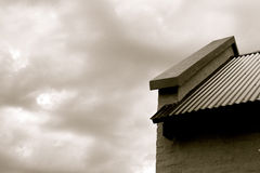 Roof and clouds. Black and white photo of roof and clouds, Roof with stormy clouds stock photography