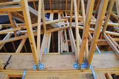 A roof connection in a radiata pine building frame. This is a home roof connection of a lower storey to an upper storey built dominantly in radiata pine. A large stock photos