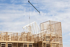 Roof construction. Roof trusses being put in place at a construction site Royalty Free Stock Images