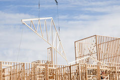 Roof construction. Roof trusses being put in place at a construction site Royalty Free Stock Image