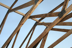 Roof Construction. Roofing Trusses in home construction.  Ceiling and roof truss Stock Image
