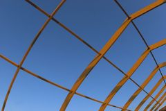 Roof Construction. Unfinished wooden roof construction over the blue sky Stock Images
