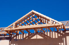 Roof construction against the blue sky. View of new roof construction against the blue sky Royalty Free Stock Photo