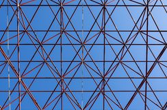Roof construction with blue sky. Image shows an abstract celling metal construction on blue sky background royalty free stock photo