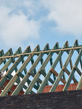 Roof construction, wooden structure skeleton. Vertical view. Stock Image