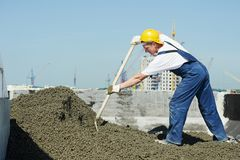 Roof construction. worker roofer leveling with float lute royalty free stock images