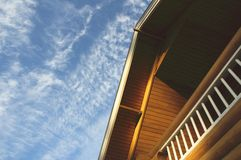 Roof of contry house. Over blue sky Royalty Free Stock Photos
