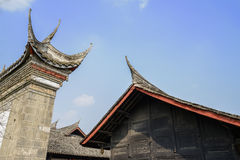 Roof and cornices of ancient Chinese building in blue sky Stock Photography
