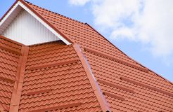 The roof of corrugated sheet red orange Stock Images