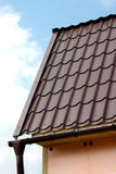 Roof of a country house covered with brown tile Stock Photo