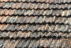 Roof is covered with brown tiles close up Stock Photography