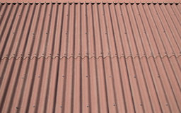 The roof is covered with modern brown siding. Texture Background. Royalty Free Stock Images