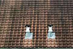 Weathered roof with two ventilation chimneys royalty free stock image