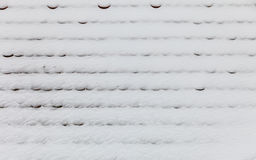 Roof covered with snow background texture. Stock Photos