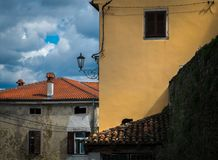 Roof of Croatia. The roofs of the old Croatian town of Poreč. A cat on a tiled roof stock photo