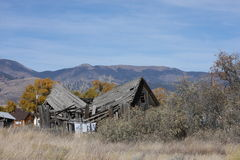 Roof Damage. This Colorado house has seen better days. However the Mountains look good Royalty Free Stock Photos