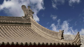 Roof decorations on the territory Giant Wild Goose Pagoda, is a Buddhist pagoda located in southern Xian Sian, Xi`an,  China stock video footage