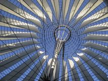 Roof detail and blue sky. Sunny illuminated roof detail of the Sony Center in Berlin (Germany royalty free stock photo