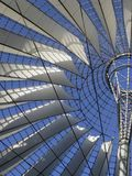 Roof detail and blue sky. Sunny illuminated roof detail of the Sony Center in Berlin (Germany stock photo