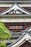 Roof detail on an old wood Japanese castle. Classic Japanese roof details with windows Stock Photo