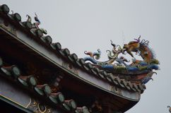 Roof details of the Buddhist Dalongdong Baoan Temple in Taipei, Taiwan. The buddhist Dalongdong Baoan Temple in Taipei city, Taiwan. Details of the Main Hall`s royalty free stock photo