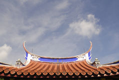 Roof details of a Chinese Temple. One of the roofs of Lian Shan Shuang Lin Monastery in Singapore.  It is the oldest Buddhist Monastery in Singapore and is Stock Image