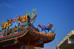 The roof and door of the shrine have a dragon statue. Chinese art in Thailand Chinese culture stock images