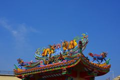 The roof and door of the shrine have a dragon statue. Chinese art in Thailand Chinese culture stock image