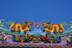 The roof and door of the shrine have a dragon statue. Chinese art in Thailand Chinese culture royalty free stock images
