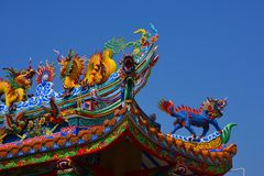 The roof and door of the shrine have a dragon statue. Chinese art in Thailand Chinese culture stock photography