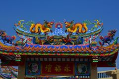 The roof and door of the shrine have a dragon statue. Chinese art in Thailand Chinese culture royalty free stock photography