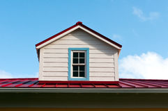 Roof Dormer. A white dormer on a red roof Royalty Free Stock Image
