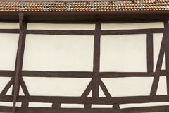 Roof and facade of a house with typical half timbered style. Roof and facade of a house in German town Bad Bruckenau with typical half timbered style Stock Photos