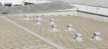Roof of factory with roof ventilators. In sunshine day Stock Image
