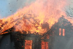 Roof fire with debris Stock Photography