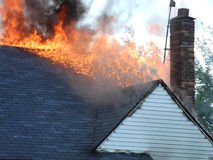 Roof on fire Stock Images