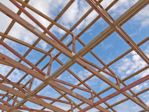 Roof frame construction under cloudy blue sky Royalty Free Stock Image
