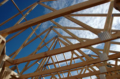 Roof frame rafters. Rafters of the roof frame of a house under construction stock photography