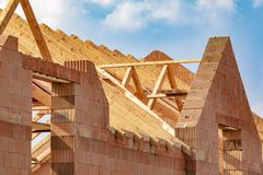 Roof frame rafters. Building a new house. Roof frame rafters. Building a new house with cloudy sky stock images