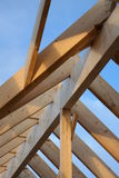 Roof framework. Wooden framework of roof under construction with blue sky in the background Stock Photography