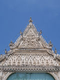 Roof front Thai art in temple under blue sky Stock Photos