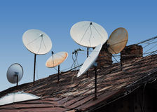 Roof full of satellite dishes Royalty Free Stock Photo