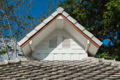 Roof gable with concrete roof tile. White roof gable with white concrete roof tile Stock Photo
