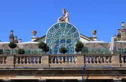 Roof garden. A rooftop garden with trees, statues and a glass structure stock photos