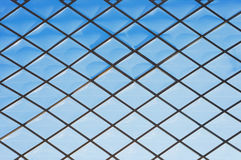 Roof glass modern windows metal grid blue sky pattern royalty free stock photography